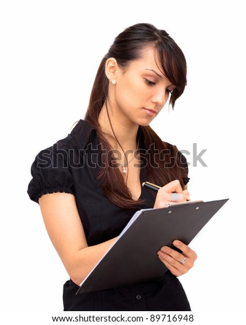 The beautiful business woman writes on a white background