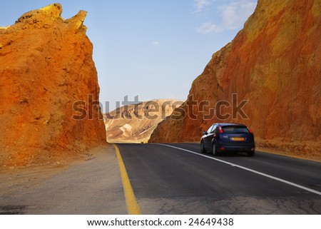 The beautiful car on highway in stone desert at Red sea
