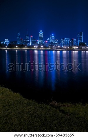 The beautiful city of Montreal at night.  View from Bassin Peel.
