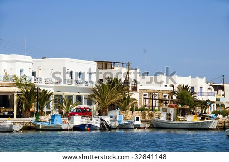 the beautiful  classic port harbor of antiparos island in the cyclades greece with boats and hotels and classic greek island architecture