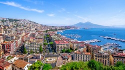 the beautiful coastline of napoli under a blue sky