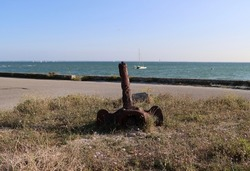 The beautiful coastline of the peninsula of Quiberon in Brittany and the old anchor , French department of Morbihan