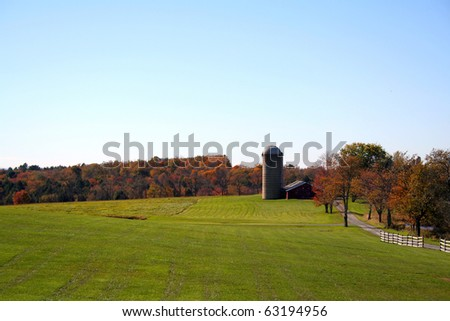 The beautiful colors of autumn surround this rural country farm in rural New York, Catskill Mountains