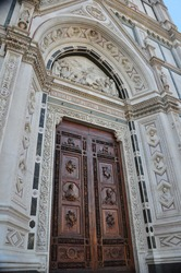 The beautiful entrance of the Basilica of Santa Croce in Florence Italy. This landmark is the final resting place of Michelangelo and Galileo.  Also Renaissance art is on display.