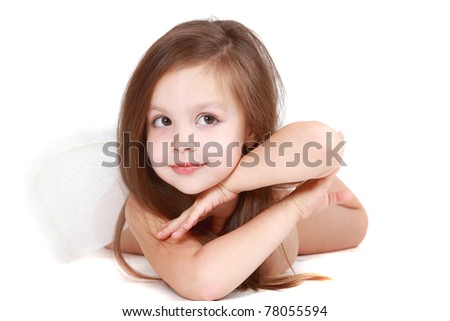 The beautiful four-year girl with angelic wings behind the back on a white background