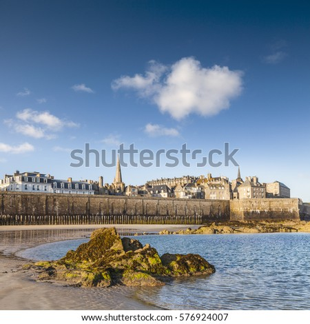 The beautiful French port of St Malo on a bright sunny morning, from the beach.