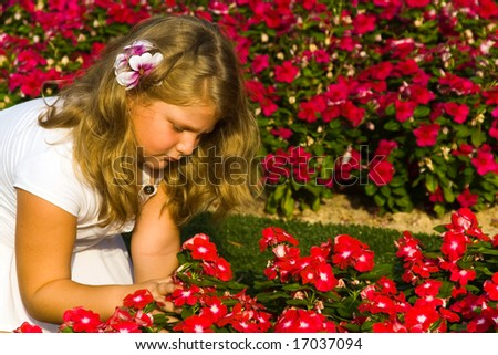 The beautiful girl among flowers