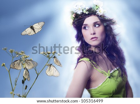 The beautiful girl and butterflies against the blue sky.