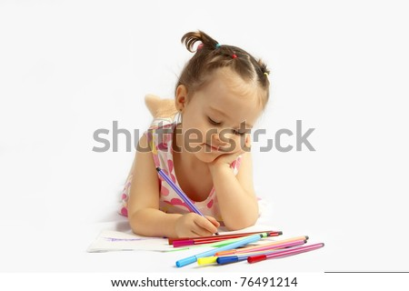 The beautiful girl drawing pencils in a sketch pad on the isolated white background