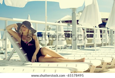 The beautiful girl has a rest on the yacht