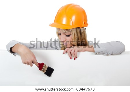 The beautiful girl in a building helmet