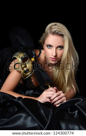 The beautiful girl in a carnival mask