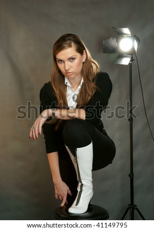 The beautiful girl in a photographic studio