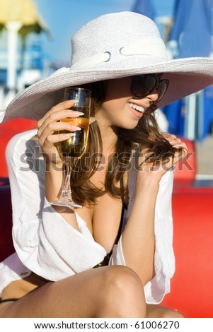 The beautiful girl in a white hat
