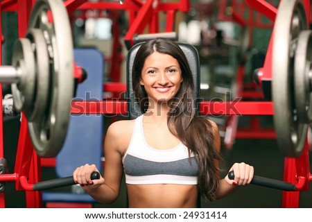 The beautiful girl in sports club. Look other photos of this series: