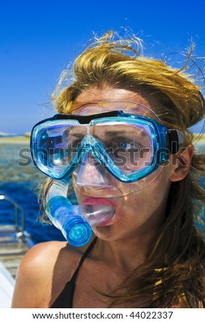 The beautiful girl is snorkeling with a mask in a red sea - stock photo