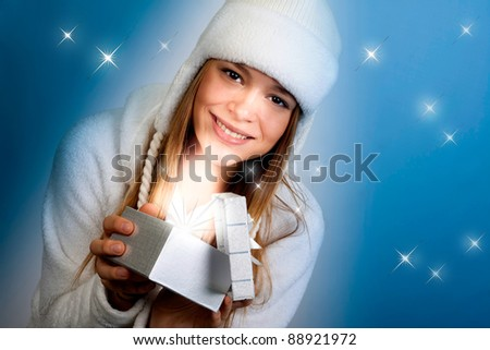 The beautiful girl looks a gift. Christmas.