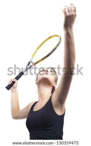 The beautiful girl plays tennis.