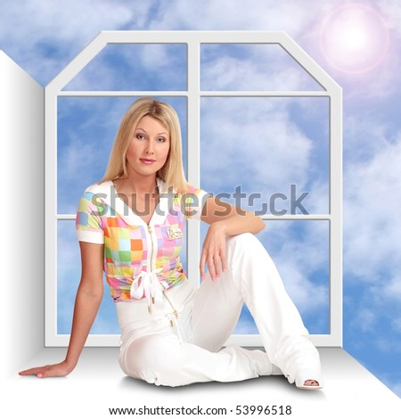 The beautiful girl sits on a window sill a back to a window. Behind a window the sun in the dark blue sky with clouds.