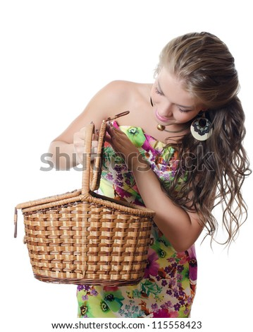The beautiful girl with a basket isolated