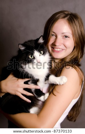The beautiful girl with a black cat