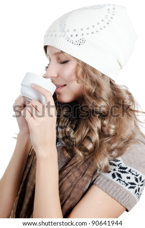 The beautiful girl with a coffee cup