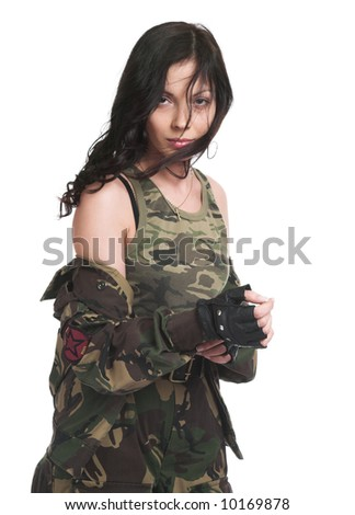 The beautiful girl with a rifle on a white background - stock photo