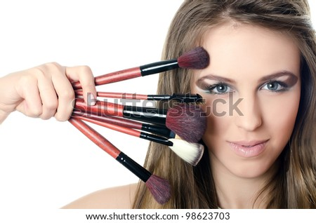 The beautiful girl with brushes for make-up