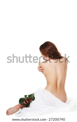 The beautiful girl with flowers touches a body