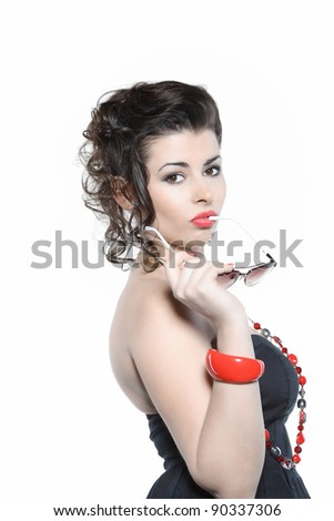 The beautiful girl with points and ornaments on a white background