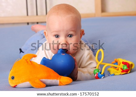 The beautiful happy baby plays with toys 2