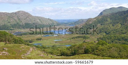 """The beautiful Lakes of Killarney, nestling among the Kerry mountains on a sunny summer day.  This scenic view of the valley was taken from the """"Ladies' View"""" vantage point."""