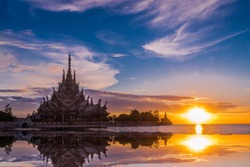 The Beautiful Landmark view of a sculpture of Sanctuary of Truth temple  with sunset sky background in Pattaya , Chonburi, Thailand.