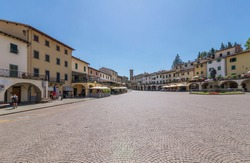 The beautiful Matteotti square in triangular shape in the historic center of Greve in Chianti, Florence, Tuscany, Italy