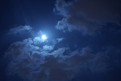 The beautiful night sky with the round moon and cloudy sky