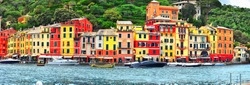 The beautiful Portofino panorama with colorfull houses, luxury boats and yacht in little bay harbor. Liguria, Italy