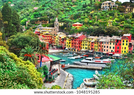 The beautiful Portofino panorama with colorfull houses, luxury boats and yacht in little bay harbor. A vacation resort with celebrity visitors. Liguria, Italy,Europe