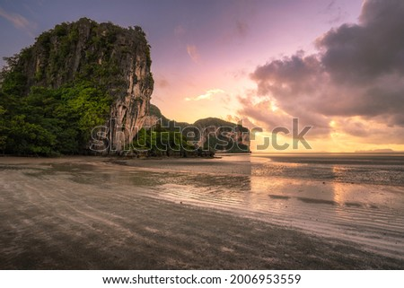 The beautiful scenery of the Rajamangala beach at sunset time with twilight sky at Trang province, Thailand.