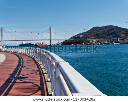 The beautiful seafront of Yeosu city and big arch bridge on the background. South Korea #1178014282