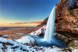 The beautiful Seljalandsfoss in Iceland during winter