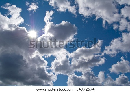 The beautiful sky with clouds and sun.