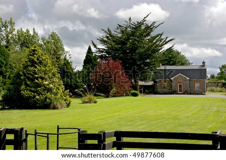 The beautiful stone house and garden, Ireland - stock photo