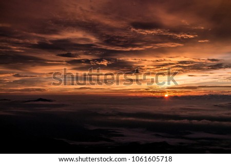 The beautiful sunrise above the clouds in the paraná peak. #1061605718