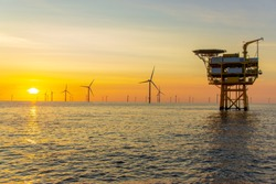 The beautiful sunset in the North Sea offshore wind farm