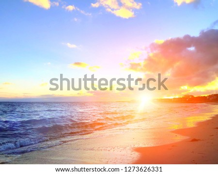 The beautiful sunset shining on the surface of sea on hyannis port beach in winter in barnstable hyannis Massachusetts United States.