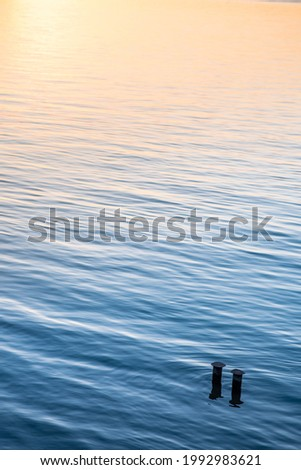The beautiful vertical wallpaper of tranquil water at sunset