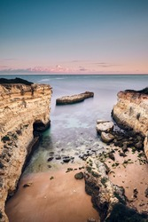 The beautiful view of cliffs during the sunset Albandeira, Algarve, Portugal