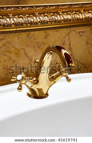 The beautiful water faucet from bronze in a bathroom