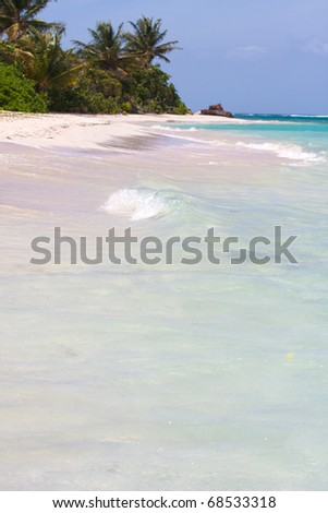 The beautiful white sands Flamenco beach located on the Puerto Rican island of Culebra.  Shallow depth of field with sharpest focus on the waves. - stock photo
