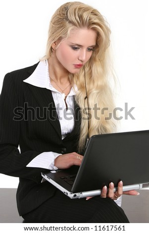 The beautiful woman prints the text on a portable computer (isolated on white)